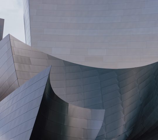 An outside view of Walt Disney Concert Hall in Los Angeles featuring curved steel edges.